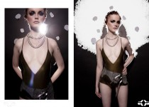 | deep cut maillot > leather hip slung belt > chainmaille necklace | by Alejandra Guerrero